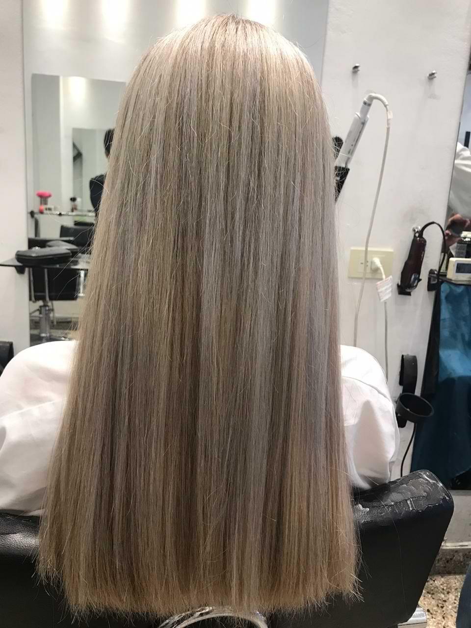 Corte de pelo largo para dama y alisado perfecto